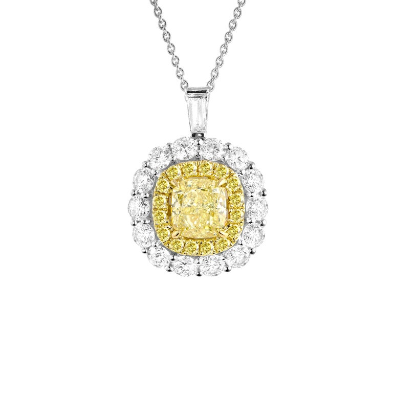 GIA Certified 0.66 Carat Natural Fancy Yellow Diamond Pendant with Halo For Sale