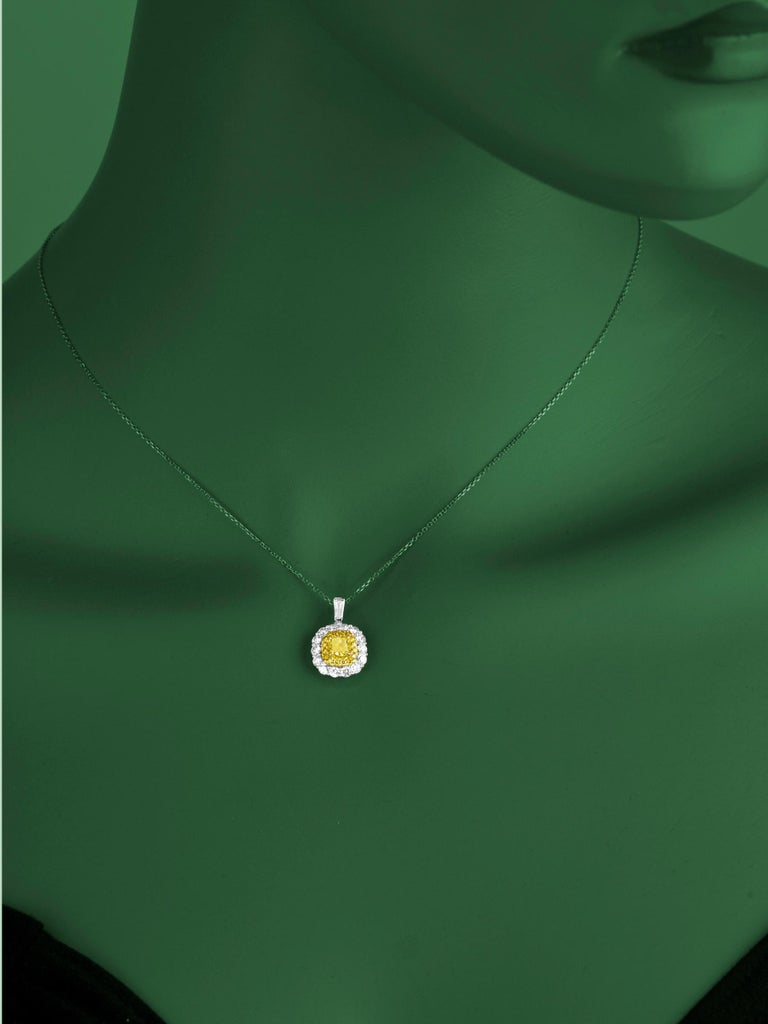 Contemporary GIA Certified 0.66 Carat Natural Fancy Yellow Diamond Pendant with Halo For Sale