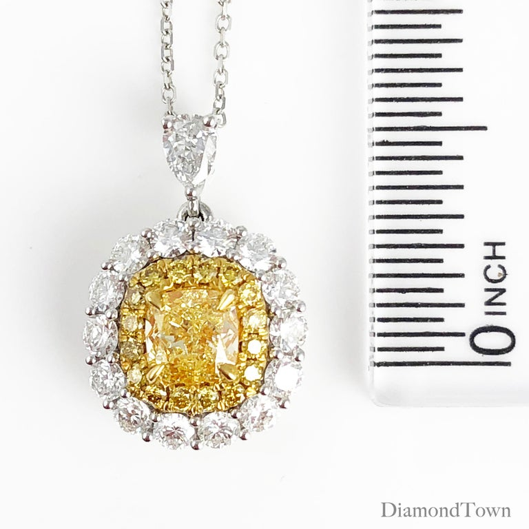 Cushion Cut GIA Certified 0.66 Carat Natural Fancy Yellow Diamond Pendant with Halo For Sale
