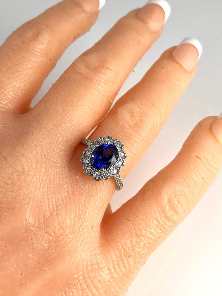 Contemporary 2.06 Carat Vivid Blue Tanzanite and 0.34 Carat Diamond Cocktail Cluster Ring For Sale