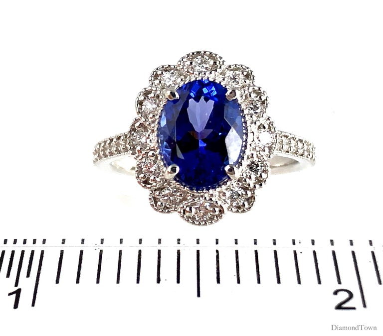 Oval Cut 2.06 Carat Vivid Blue Tanzanite and 0.34 Carat Diamond Cocktail Cluster Ring For Sale