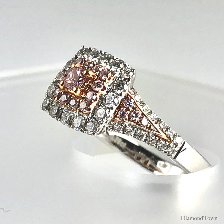 This gorgeous halo ring features a 0.09 carat Natural Pink Color Diamond center, surrounded by a square double halo of round pink and round white diamonds. The total diamond weight is 0.64 carats.  Set in 18k White and Rose Gold  There is a seasonal