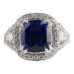 3.59 Carat Cushion Cut Blue Sapphire and Diamond Ring in 18 Karat White Gold