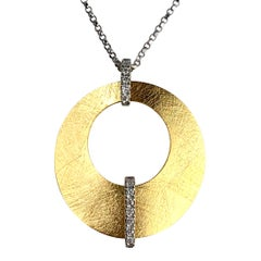 0.13 Carat Diamond Pendant in 14 Karat Yellow and White Gold