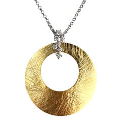 0.14 Carat Diamond Pendant in 14 Karat Yellow and White Gold
