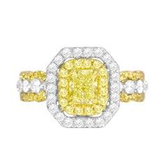 GIA Certified 0.70 Carat Natural Fancy Yellow Diamond Halo Ring