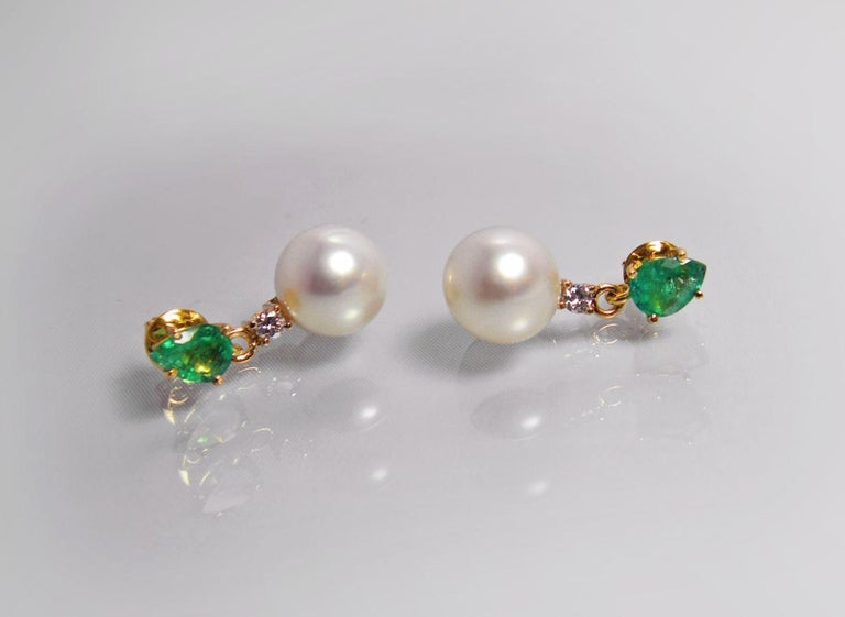 Composition: Yellow Gold 18K  Primary Stones: 100% Natural Colombian Emeralds (Minor Oiled) Shape or Cut : Pear Cut  Average Color/Clarity : AAA Medium Green/ Clarity, VS/SI  Total Emeralds Weight: 2.24 Carats (2 Emeralds) Emeralds Measurements: