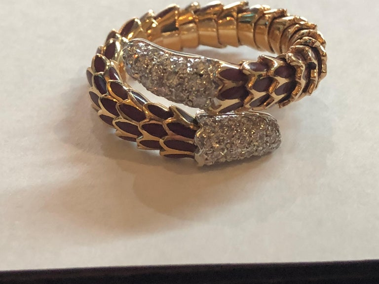 Roberto Coin 40 Diamond Enamel 18K Rose Gold Snake Design Ring Size 5.5 and it is flexible so it can be worn on multiple fingers 40 diamons that Are VS in clarity and F-G in Color  .40 ct total diamond weight 18k Rose Gold weighing 11.0