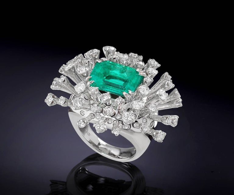 Amazing 18k white gold ring inspired by the Sea Anemone with a Colombian emerald 6.26 ctw and 94 Diamonds 3.65 ctw. This natural  light green and transparent emerald measures mm 10.83x12.54x7.10 and it is accompanied by IGI Report. US finger size is