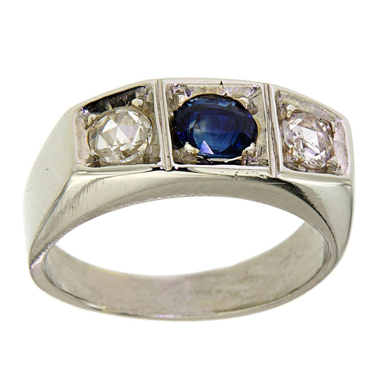 This handsome antique gents White 18k Gold Ring is set with a Sapphires approximately 1.00 ctw and 2 Diamonds Rose cut approximately 0.20 ctw. The ring is currently a size 8 and can easily be re-sized.