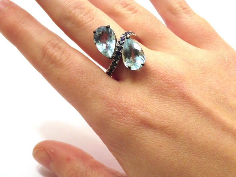 18 K white gold cocktail ring with two natural aquamarine gemstones 7,40 ctw and sapphires 0,45 ctw. It  is stamped with the Italian Mark 750 - 716MI Ready for delivery. It can be shipped with express delivery on