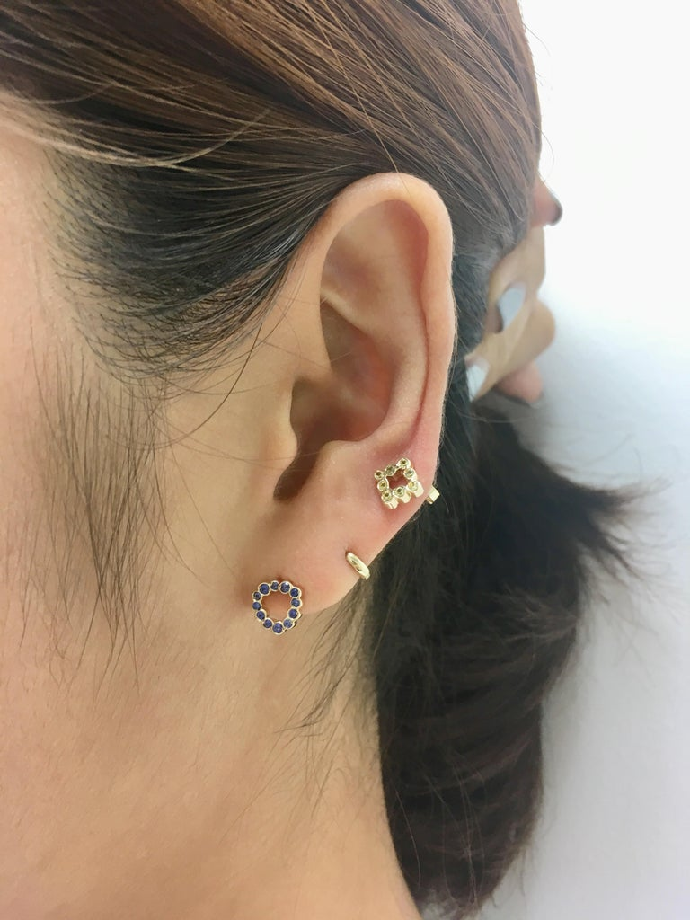 Wear these miniature triangle shaped stud earings with Blue Sapphires for a punch of color on your ears. Mix and match with your favorite single earrings or wear them as a pair.  Inspired by seeing the cross-section view of life, as if slicing a