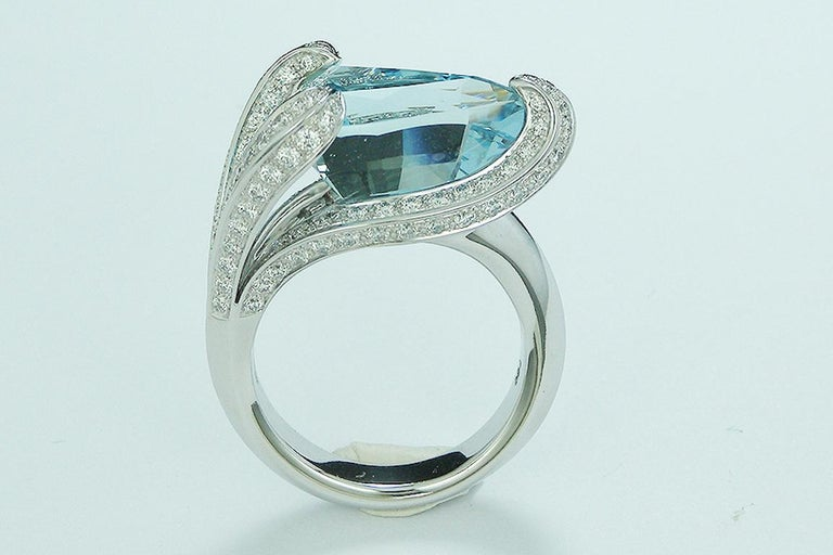 This amazing De Falbert Creation Ring features a 7.67 Carat Trillion Cut Aquamarine . Surrounded by 125 Round Cut Diamonds that weigh 1.28 Carat.  Elegantly set in 18 Karat White Gold  (7.67 Grams) The ring is a size 6.5 and can be re-sized.   All