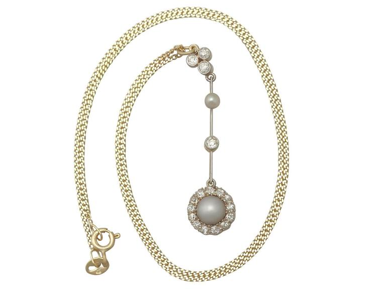 An exceptional, fine and impressive antique Victorian pearl and 0.42 carat diamond, 18 karat yellow gold and silver set pendant; part of our diverse antique jewellery and estate jewelry collections  This exceptional, fine and impressive pearl and