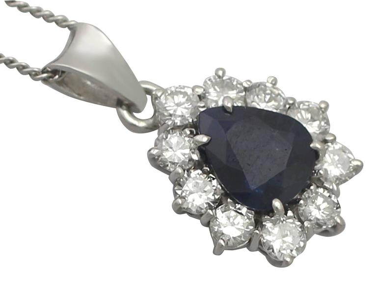 A fine and impressive 1.25 carat blue sapphire and 0.50 carat diamond, 14 karat white gold pendant; part of our diverse vintage jewellery and estate jewelry collections  This fine and impressive vintage sapphire pendant has been crafted in 14k white