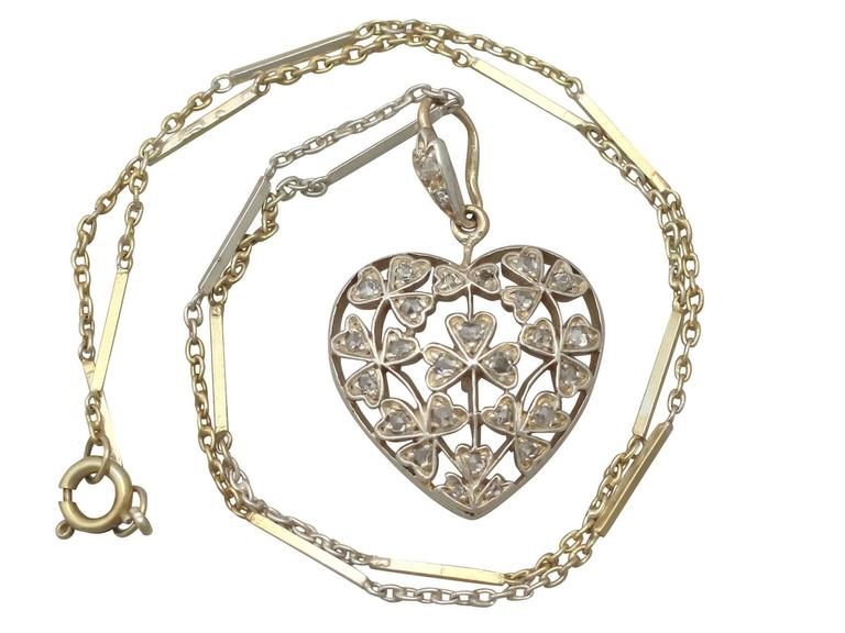 An exceptional, fine and impressive antique Victorian 0.70 carat diamond and 12 karat yellow gold, silver set heart shaped pendant; part of our diverse antique jewellery and estate jewelry collections  This exceptional, fine and impressive diamond