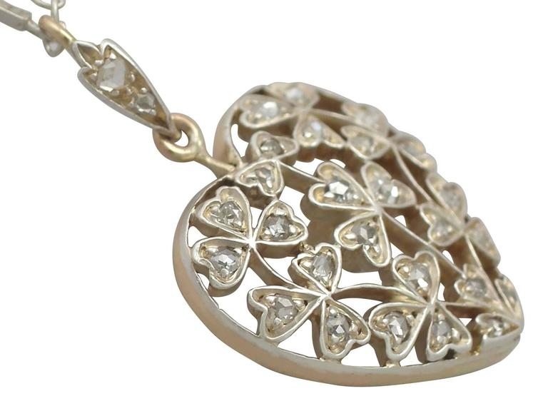 Antique Victorian 0.70 Carat Diamond and 12k Yellow Gold Pendant 3