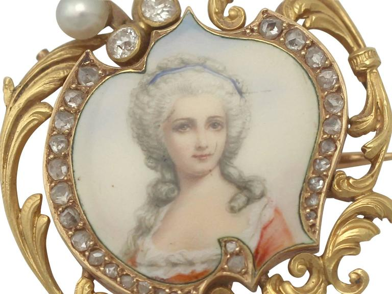 This stunning, fine and impressive antique enamel brooch has been crafted in 18k yellow gold.  The pierced decorated, asymmetrical setting displays a feature hand-painted enamel miniature portrait, depicting a young lady in period dress.  The