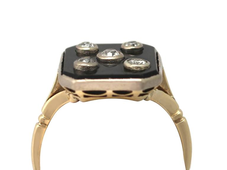 A fine and impressive black onyx and 0.40 carat diamond (total), 18 carat yellow gold dress ring with 18 carat white gold settings; part of our diverse antique jewellery and estate jewelry collections  This fine and impressive antique diamond and
