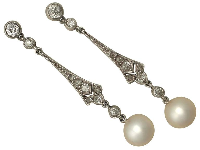 A fine and impressive pair of vintage pearl and 0.38 diamond, platinum drop earrings; part of our vintage jewellery and estate jewelry collections