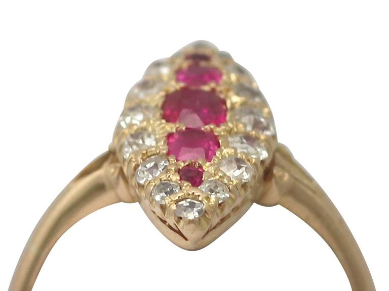 A fine and impressive 0.62 carat ruby and 0.46 carat diamond, 18 karat yellow gold marquise shaped dress ring; part of our diverse antique jewellery and estate jewelry collections  This fine and impressive ruby marquise ring has been crafted in 18k