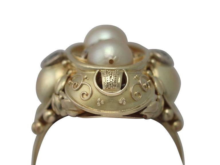 An impressive cultured pearl and 0.72 carat diamond, 14 karat yellow gold and 14 carat white gold dress ring; part of our diverse antique jewellery and estate jewelry collections  This fine and impressive pearl and diamond ring has been crafted in