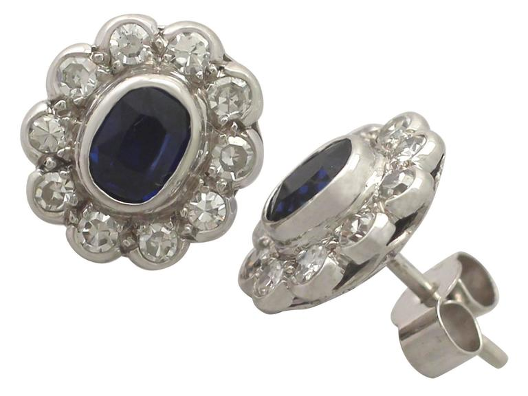 An impressive pair of antique 0.84 Carat blue sapphire and 0.80 Carat diamond, 18 karat white gold stud earrings; part of our diverse antique jewellery collections  These fine and impressive antique sapphire and diamond earrings have been crafted in