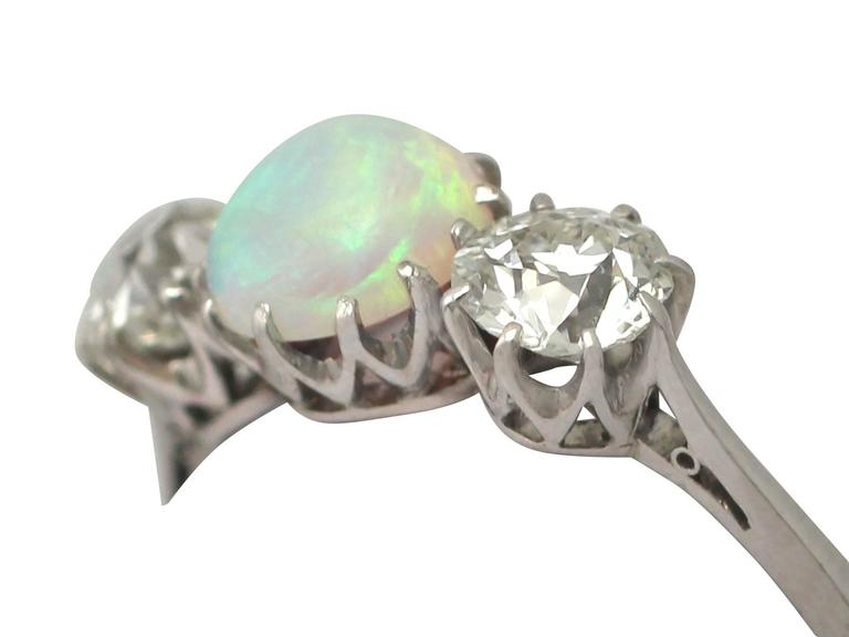Round Cut Antique Opal and 1.08 Carat Diamond Gold Trilogy Ring For Sale