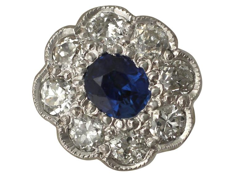 A fine and impressive pair of 0.92 Carat blue sapphire and 1.02 Carat diamond, 18 karat white gold cluster style stud earrings; part of our diverse antique jewelry collections  These fine and impressive sapphire and diamond earrings have been