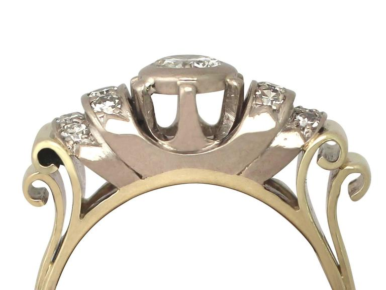 An impressive 0.61 carat diamond and 14 carat kellow gold, 10 karat white gold set dress ring; part of our diverse vintage jewellery and estate jewelry collections  This fine and impressive dress ring has been crafted in 18 4 k yellow gold with a 10