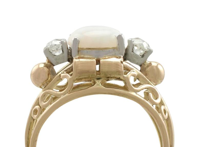An impressive antique 1.82 carat white opal and 0.35 carat diamond, 18 karat yellow gold and platinum set cocktail ring; part of our diverse antique jewelry collections  This fine and impressive antique opal and diamond ring has been crafted in 18 k