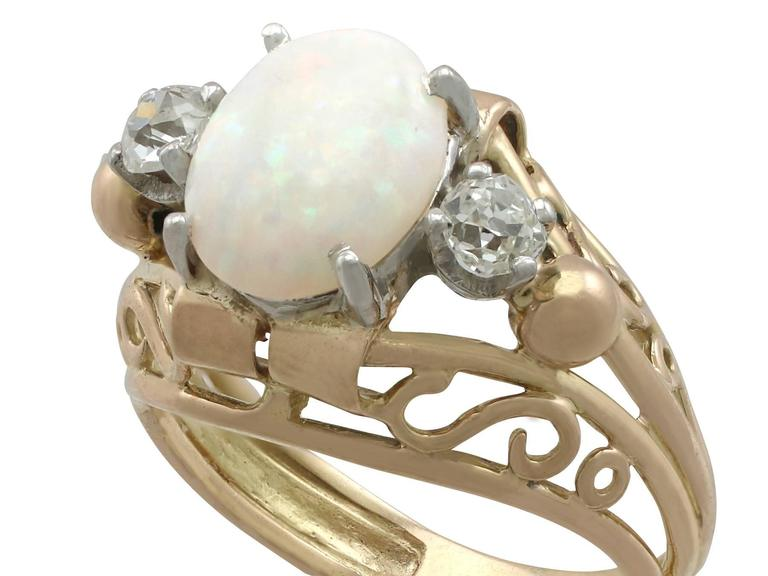 Round Cut 1930s French 1.82 Carat Opal and Diamond Yellow Gold Ring For Sale