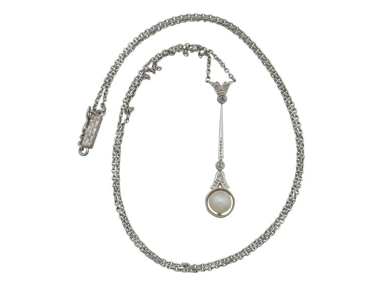 An impressive antique seed pearl and 0.05 carat diamond, 14 karat yellow gold and silver set necklace; part of our diverse antique jewelry collections  This fine and impressive pearl necklace with diamonds has been crafted in 14 k yellow gold with a