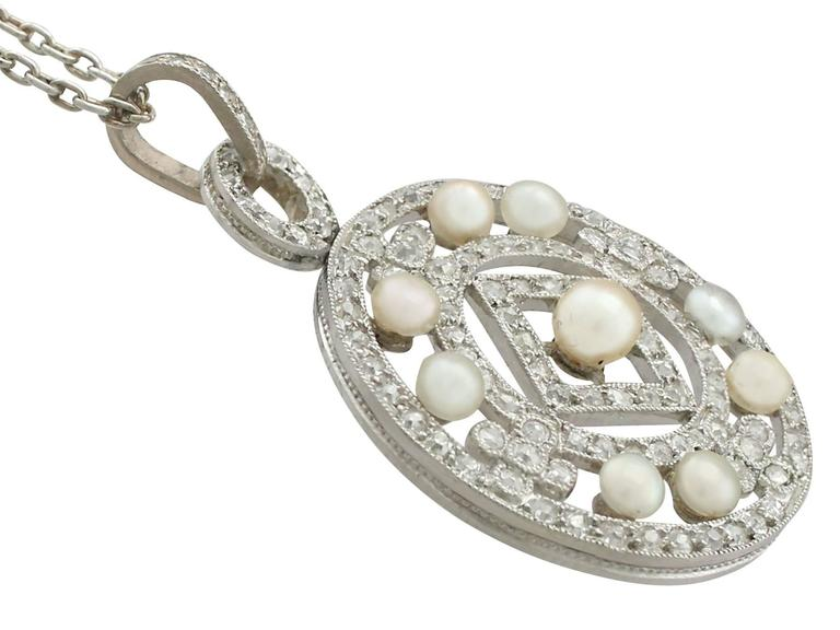 Romantic 1920s Seed Pearl and 1.11 Carat Diamond, Platinum Pendant For Sale