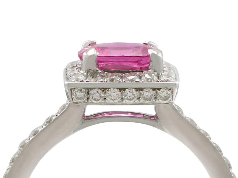 A stunning 1.27 carat pink sapphire, 0.60 carat diamond and 18 karat white gold halo style cocktail ring; part of our diverse antique jewelry and estate jewelry collections  This stunning, fine and impressive pink sapphire ring has been crafted in