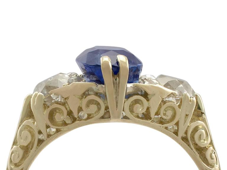 A stunning antique Victorian 3.11 carat sapphire and 0.90 carat diamond, 18 karat yellow gold trilogy ring; part of our diverse antique jewelry collections  This stunning, fine and impressive antique Victorian sapphire ring has been crafted in 18k