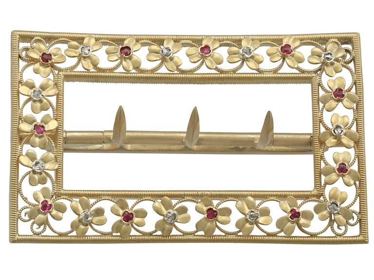 An exceptional Victorian 0.19 carat ruby and 0.18 carat diamond, 20 karat yellow gold belt buckle; part of our diverse antique jewelry and estate jewelry collections  This exceptional Victorian belt buckle has been crafted in 20k yellow gold.  The