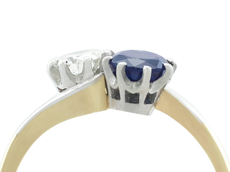 An impressive vintage 0.40 carat diamond and 0.72 carat sapphire, 18k yellow gold and platinum set twist ring; part of AC Silver's diverse gemstone jewelry collections.  This fine and impressive sapphire and diamond twist ring has been crafted in