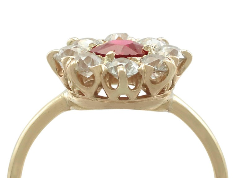 An impressive antique 0.63 carat ruby and 0.60 carat diamond, 18 karat yellow gold cluster ring; part of diverse antique jewelry collections  This fine and impressive antique ruby cluster ring has been crafted in 18k yellow gold.  The pierced