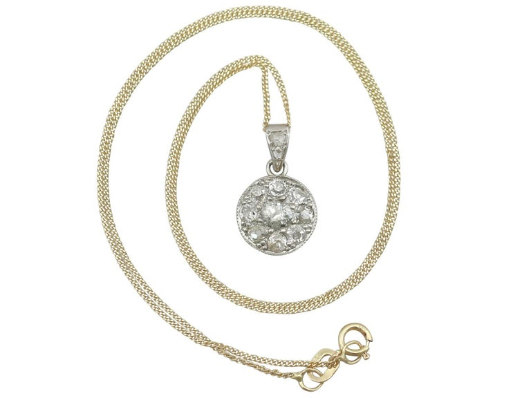 An impressive antique 0.61 carat diamond and 15 karat yellow gold, platinum set pendant; part of diverse antique jewelry and estate jewelry collections  This fine and impressive diamond pendant has been crafted in 15k yellow gold with a platinum
