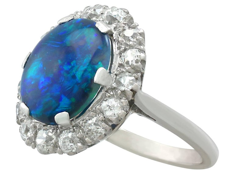 Old European Cut 1930s Black Opal and Diamond Platinum Cluster Ring