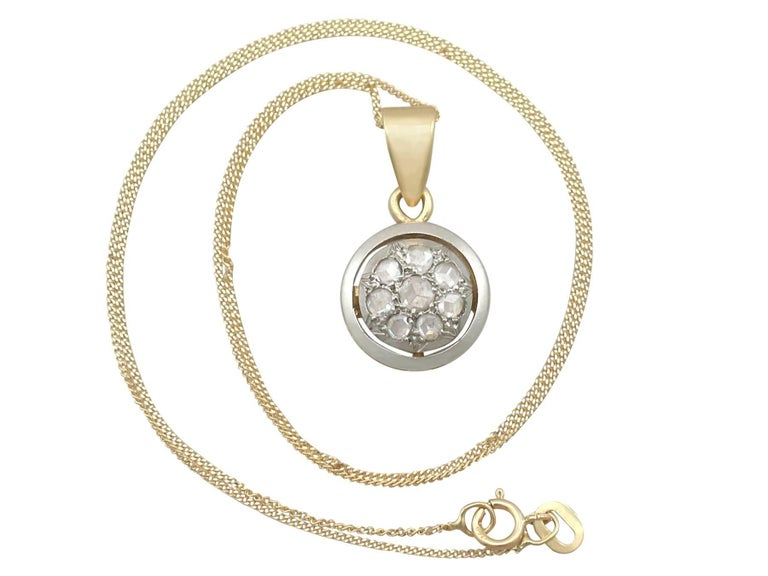 An impressive antique European 0.35 carat diamond and 18 karat yellow gold, 18 karat white gold set pendant; part of our diverse antique jewelry and estate jewelry collections  This fine and impressive antique 1920's diamond pendant has been crafted