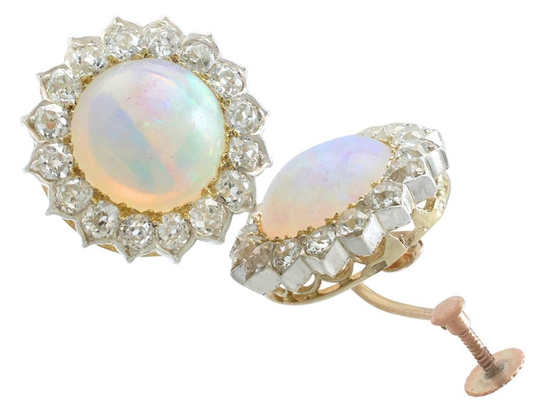 An impressive pair of 7.76 carat white opal and 2.05 carat diamond, 9 karat yellow gold and 9 karat white gold set clip on earrings; part of our diverse antique jewelry collections  These fine and impressive Victorian opal earrings have been crafted