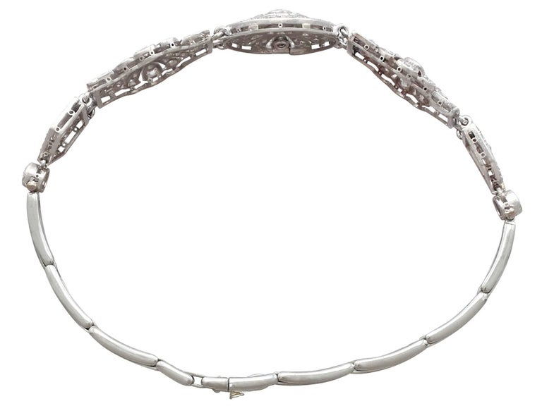 A stunning vintage 1940's Art Deco 4.48 carat diamond and platinum bracelet; part of our diverse antique jewellery and estate jewelry collections.  This stunning, fine and impressive diamond bracelet has been crafted in platinum.  The fully