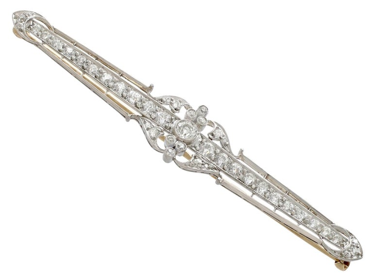 An impressive antique 2.78 carat diamond and 15 karat yellow gold, platinum set bar brooch; part of our diverse antique jewellery and estate jewelry collections.  This fine and impressive diamond bar brooch has been crafted in 15k yellow gold with a