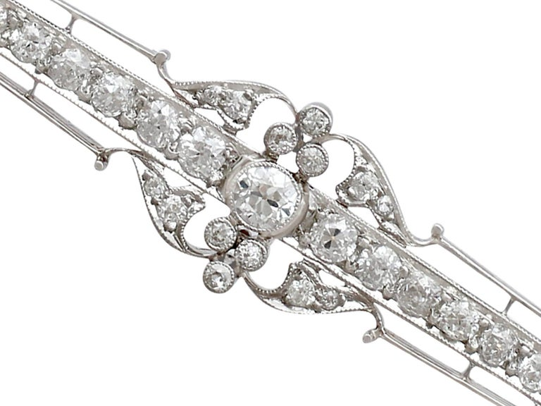 Round Cut 2.78 Carat Diamond and Yellow Gold, Platinum Set Bar Brooch For Sale