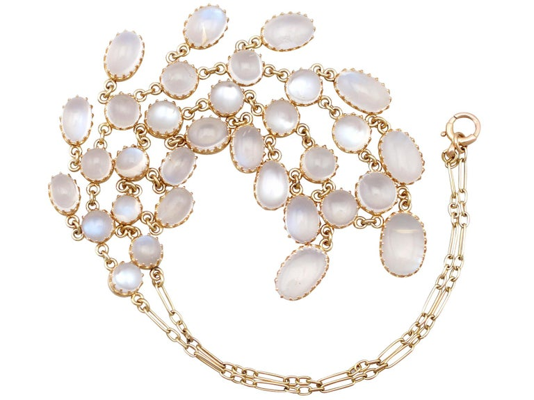 An impressive antique 1900's 42.20 carat moonstone and 9 carat yellow gold necklace; part of our diverse antique estate jewelry collections.  This fine and impressive antique moonstone necklace has been crafted in 9k yellow gold.  The necklace is
