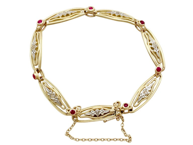 An impressive vintage French 0.21 carat ruby and 0.08 carat diamond, 18 carat yellow and white gold bracelet; part of our diverse ruby jewellery collections.  This fine and impressive gold bracelet has been crafted in 18ct yellow gold with 18ct