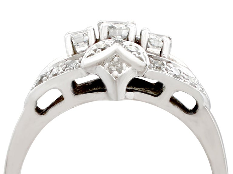 An impressive vintage 1950s 0.50 carat diamond and 14 karat white gold cocktail ring; part of our diverse diamond jewelry and estate jewelry collections.  This fine and impressive diamond cocktail ring has been crafted in 14k white gold.  The