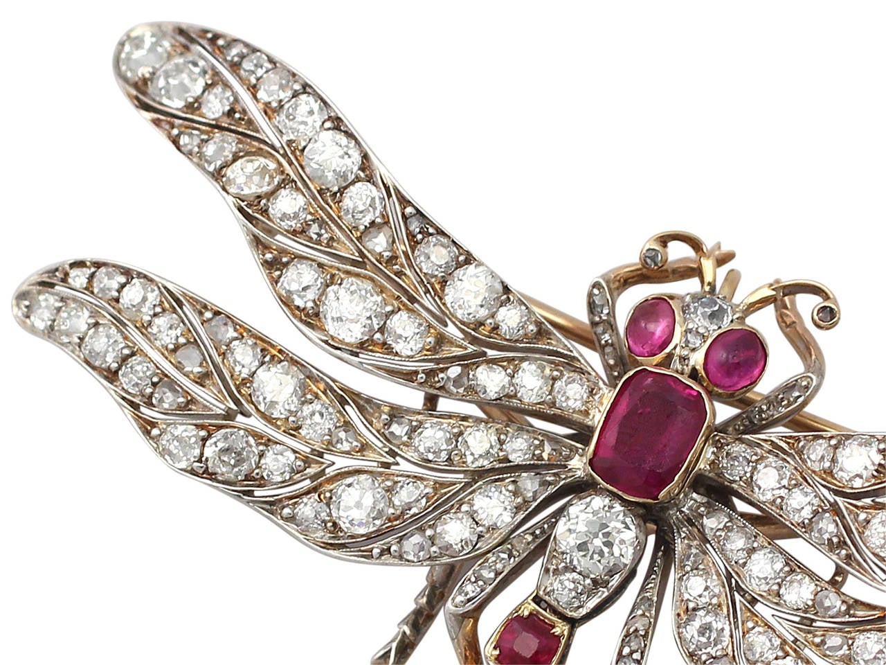 A large, stunning, fine and impressive antique 5.70 carat diamond and 3.30 carat ruby, 9 karat yellow gold dragonfly brooch; part of our antique jewelry and collections  This stunning, large antique Victorian brooch has been modelled in 9 k yellow